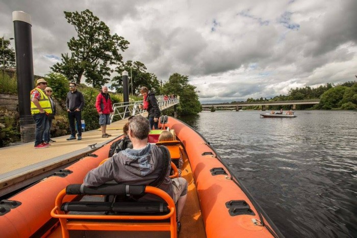 Boating on the Tay - Orange boat at pontoon