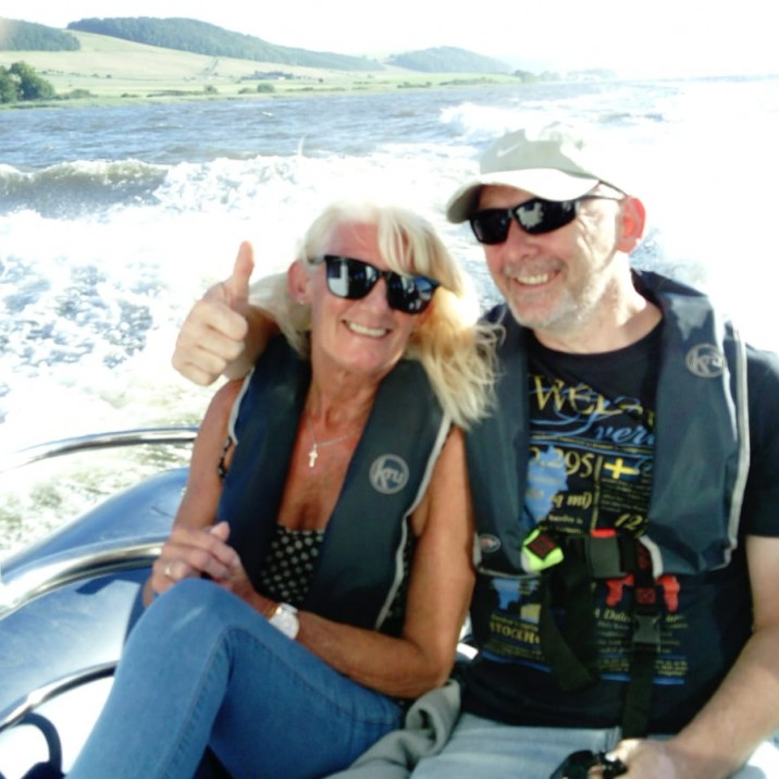 Couple enjoying the ocean breeze on the River Tay