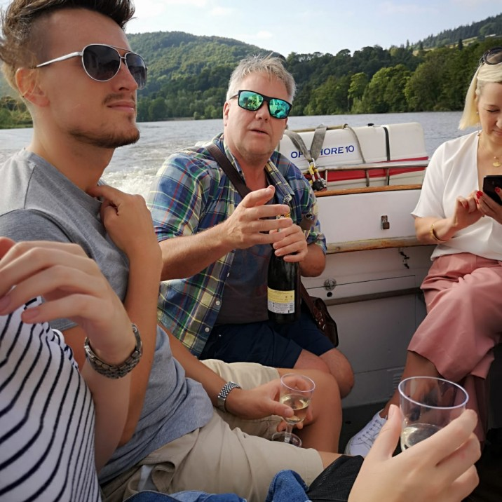 Team Small City popping the Prosecco whilst Boating on Tay