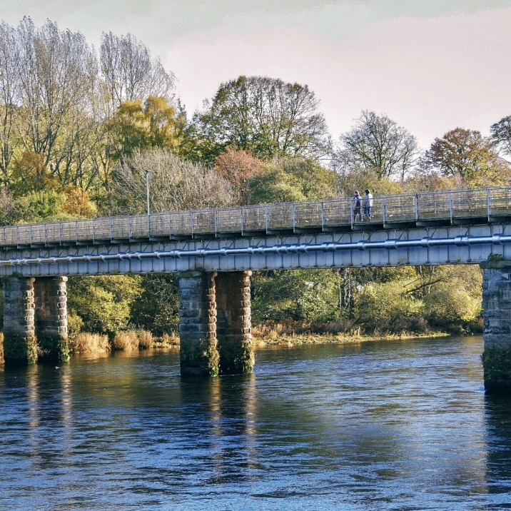 A look at the beautiful Perth Railway bridge from Tay Stree. The bridge is balanced above the flowing banks of the River Tay