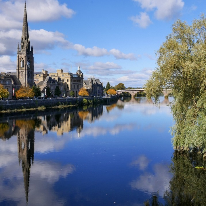 The mystical views of the reflective River Tay taken from Queens Bridge in Perth city Center looking towards Tay Street